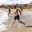 Man running at the beach — Foto de Stock