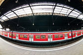 Train in train station — Stock Photo