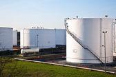 White tanks in tank farm with blue sky — Stock Photo