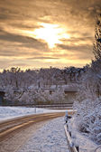 Snow covered street in sunrise in winter — Stock Photo