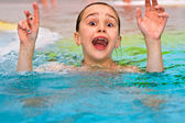 Children having fun in the outdoor thermal pool — Stock Photo