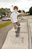 Boy skating at the skate park and has fun — Stock Photo