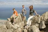 Family on top of mountain — Stock Photo