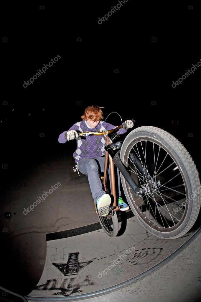 Young boy jumpy with his scooter by night with stroboscope — Stock Photo #5667188