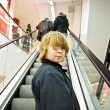 Child is smiling self confident on a stairway in a shopping mall — Photo