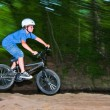 Royalty-Free Stock Photo: Child has fun jumping with th bike over a ramp
