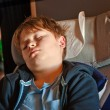 Child is sleeping in the aircraft in his seat — Stock Photo #5674949