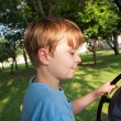 Boy likes to drive an electric car in an old palace of a former - Stok fotoğraf