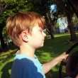 Boy likes to drive an electric car in an old palace of a former - Zdjęcie stockowe