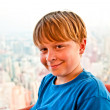 Boy enjoys the view across Bangkok skyline - Stock Photo