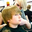 Smiling young boy at the hairdresser — Stock Photo #5676224