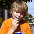 Boy enjoys icecream - Stock Photo