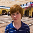 Cute boy in the old Olvera mission — Stock Photo