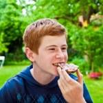 Boy eating in the garden — Stock Photo #5678244