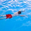 Boy diving in the pool — Stock Photo #5678645