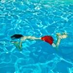 Child has fun in the pool — Stock Photo #5678802