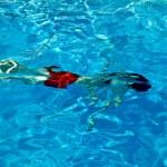 Child has fun in the pool — Stock Photo #5678825