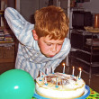 Boy blowing out his birthday candles — Stock Photo #5678916
