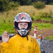 Happy boy with helmet at kart trail — Stock Photo #5679027