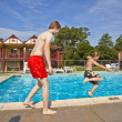Brothers having fun at the pool — Stock Photo