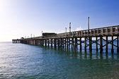 Wooden pier at miami beach — Stock Photo