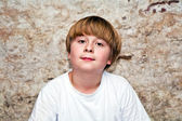 Boy with light brown hair and brown eyes lookes friendly — Stock Photo