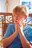 Blond boy looks astonished — Stock Photo