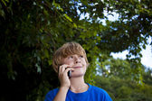 Young boy talking on a cell phone. — Stock Photo