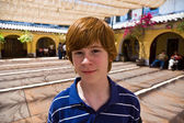 Cute boy in the old Olvera mission — Foto Stock