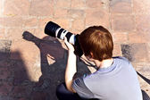 Boy takes pictures in temple area Wat Phra Si Sanphet, — Stock Photo