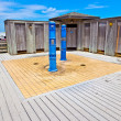 Stock Photo: Changing rooms with shower in dunes