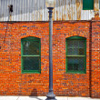 Lantern and facade of old brick house — Stock Photo