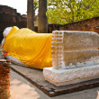 Lying Buddha dressed in yellow scarf in temple Wat Yai Chai-mong - Stock Photo