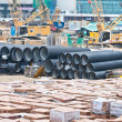 Huge water pipes are stored at the building site — Stock Photo #5687961