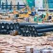 Huge water pipes are stored at the building site — Stock Photo #5687973