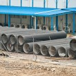 Huge water pipes are stored at the building site — Stock Photo #5687974