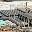Huge water pipes are stored at the building site — Stock Photo