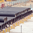 Huge water pipes are stored at the building site — Foto de Stock
