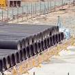 Huge water pipes are stored at the building site — Stock Photo #5688004