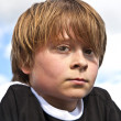 Young boy looking seriously - Stock Photo
