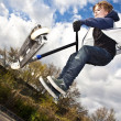Boy has fun going airborne with scooter — Stock Photo #5688105