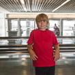 Boy on a moving staircase inside the airport — Stock Photo #5688568