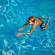 Child swims in the pool — Stock Photo #5689848