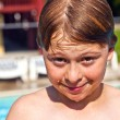 Child has fun in the pool — Stock Photo #5689964