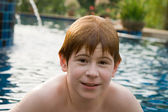 Boy with red hair in pool — Stock Photo