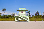 Wooden Art Deco Baywatch Huts at the l beach — Stock Photo