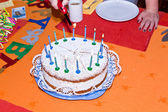Birthday cake at the table — Stock Photo