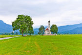 Typical bavarian or austrian landscape with a chape — Stockfoto