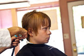 Young boys at the hairdresser — Stock Photo