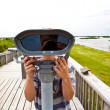Boy watching the nature through a binocular — Stock Photo #5690010